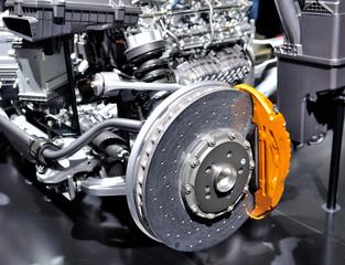 Car ceramic disc brake with yellow caliper.