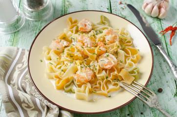 Pasta in cream sauce with shrimp