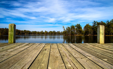Poster Lake Summer Day At The Lake. Wooden dock overlooking a gorgeous lake in the wilderness. Ludington State Park. Ludington, Michigan.