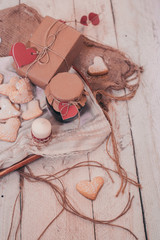 Heart shape cookies on wooden background with gift box