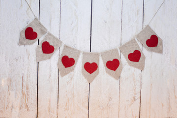 Valentine's hearts on rustic wooden texture background