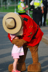 Ottawa,Canada,June 26 2008-Police Force Mascot with Young Child