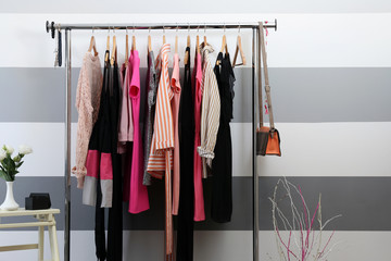 Female clothes on hangers in a room