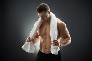Muscular Man Holding Towel Around Neck