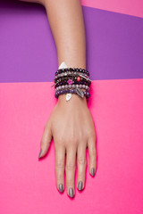 Vibrant Color, one hand hand, wearing jewelry.
