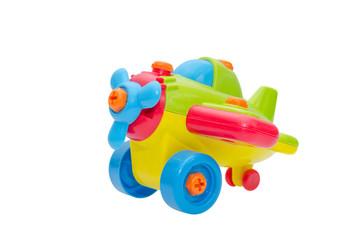 Plastic aeroplane toy isolated over white