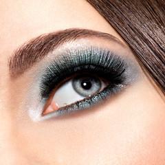 woman's eye with turquoise makeup. Long false eyelashes. macro s