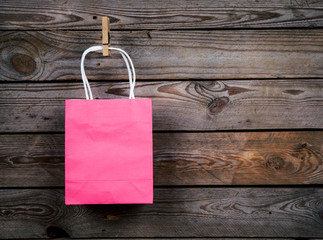 pink Shopping bag on a wooden background, sale, purchase