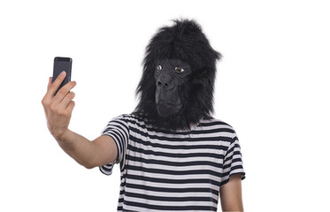 Gorilla man taking photos with his phone.
