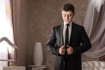 Attractive groom dress elegant suit