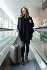 Attractive woman arriving at the airport in winter