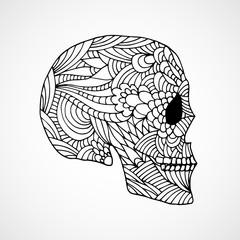 Hand drawn doodle swirled skull profile