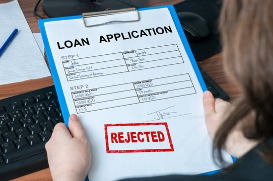 Loan application form with rejected stamp.