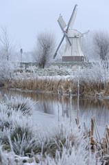 White windmill (Witte Molen)  in the frozen, Dutch landscape on a winter day. Shallow D.O.F.