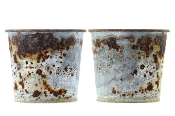 Plant pots full of flaky coating of iron oxide
