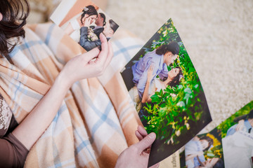 young couple looking photos