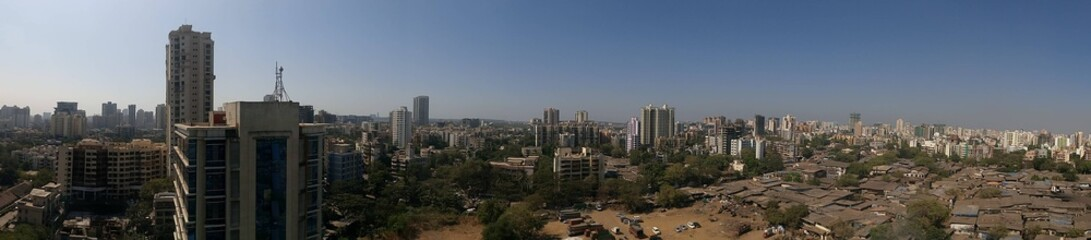 Panoramic shot of cityscape against clear blue sky