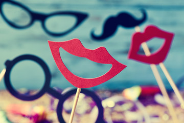 mouths, eyeglasses and mustaches on sticks