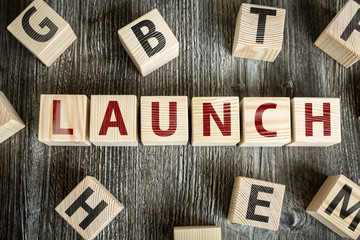 Wooden Blocks with the text: Launch