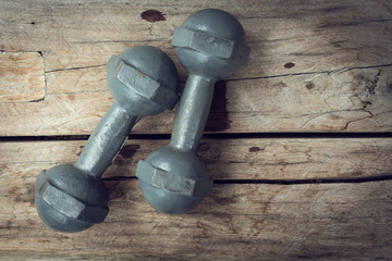 metal iron dumbbell on wood sport of fitness bodybuilding