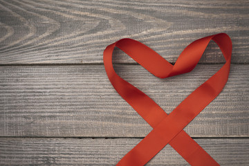 Red ribbon in the shape of heart.