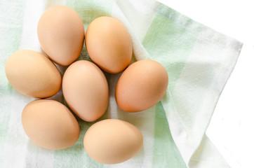 Fresh eggs in fabric.
