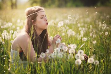 Beautiful hippie woman and dandelion