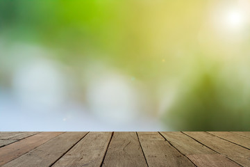 empty wood table with sunlight bokeh background for product disp