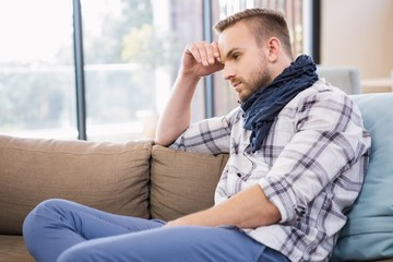 Worried man thinking on the couch