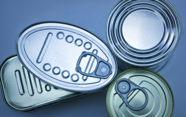 Closeup of a group of aluminium cans on blue background