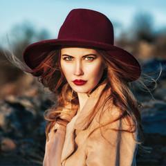 Portrait of beautiful fashionable woman wearing red hat