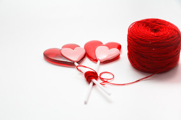 Thread ball with sweet hearts  isolated on white background