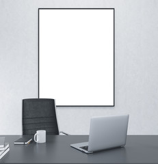 Working place with blank frame on the wall