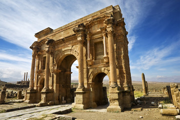 Algeria. Timgad (ancient Thamugadi or Thamugas). Triumphal arch, called Trajan's Arch and fragment of Decumanus Maximus street