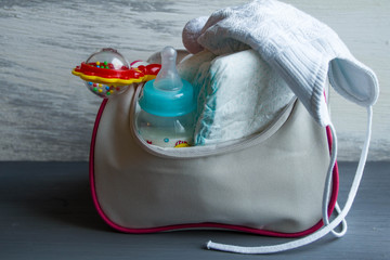 Women's handbag with items to care for the baby