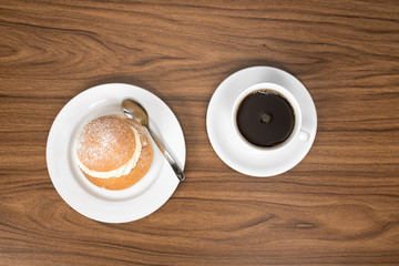 Swedish cream bun ( Semla ) served with a cup of coffee. Sen from above.
