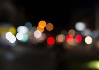 De focused/Blurred image of traffic lights. Blur lights. Light bokeh.