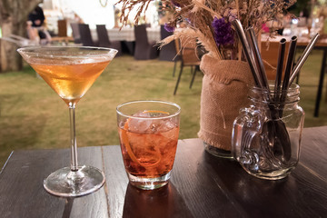 cocktail in glass on table at outdoor area