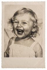 Happy Laughing Little Baby Girl. Vintage picture