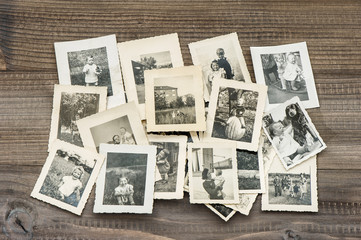Old family photos on wooden table