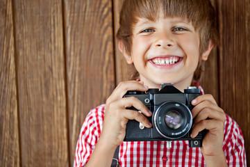 Happy kid with photo camera
