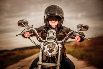 Fototapete - Biker girl on a motorcycle