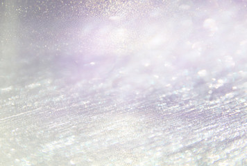 glitter vintage lights background. light silver, purple and pink. defocused.