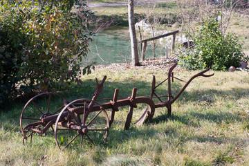 old plow in a garden