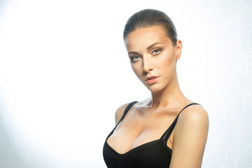 Beautiful portrait of a girl of European appearance with big breasts, wearing a black t-shirt