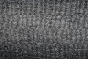 Background photo of texture of Dark grey denim jeans textile