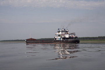 The empty barge floating on the river. Lena river. Yakutia. Russia.