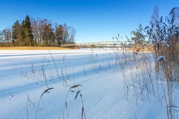 Swedish lake coast with wooden bridge