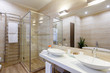bathroom of the hotel rooms, with a shower and a few washbasins