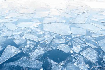 floating ice floes on water - iced winter background